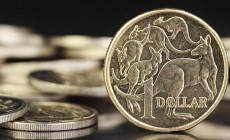 Australian dollar follows commodity prices lower